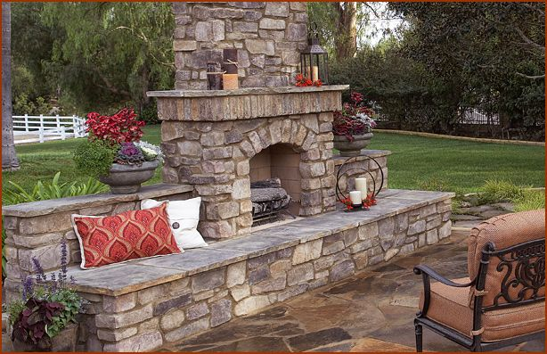 stone patio, stone outdoor fireplace, and seating  Outdoor Fireplaces