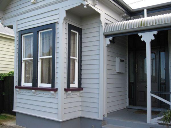 Resene Double Rakaia on house exterior - dark red window sills