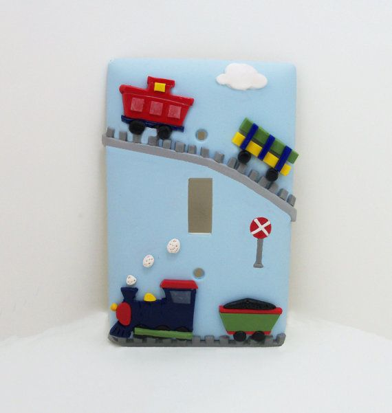 This cute train transportation themed light switch or outlet cover is perfect for your little ones room. It has been crafted with polymer clay on a