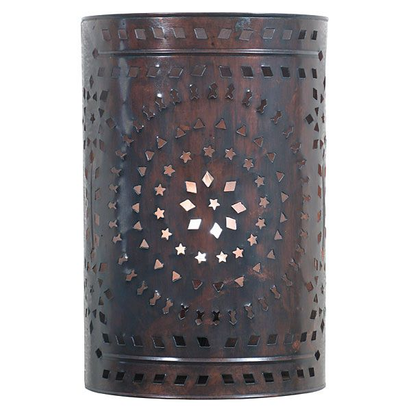 This darkened copper wall sconce with punched design will compliment any southwest or rustic decor. $73.75