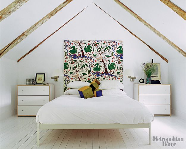 The Larsons dressed up their Min bed from Design Within Reach with a Josef Frank fabric for Svenskt Tenn through Brunschwig et Fils; the Robin bedside chests are also from Ikea.