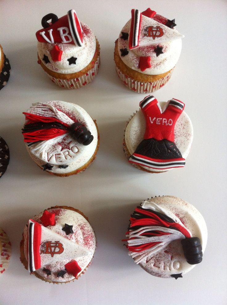Cheerleader cupcakes, Red, white and black. Megaphone, pom poms, banner, cheerleader outfit.