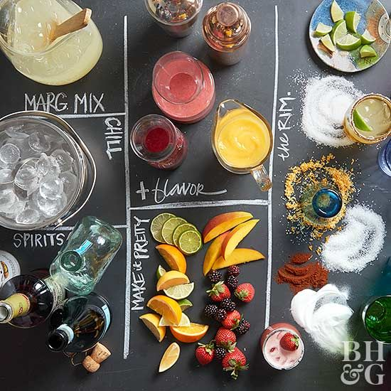 Impress your guests and set up this party-worthy margarita bar at your next gathering. With a variety of garnishes, rimmers, and boozy stir-ins, your guests will be able to customize their drinks any way they want.