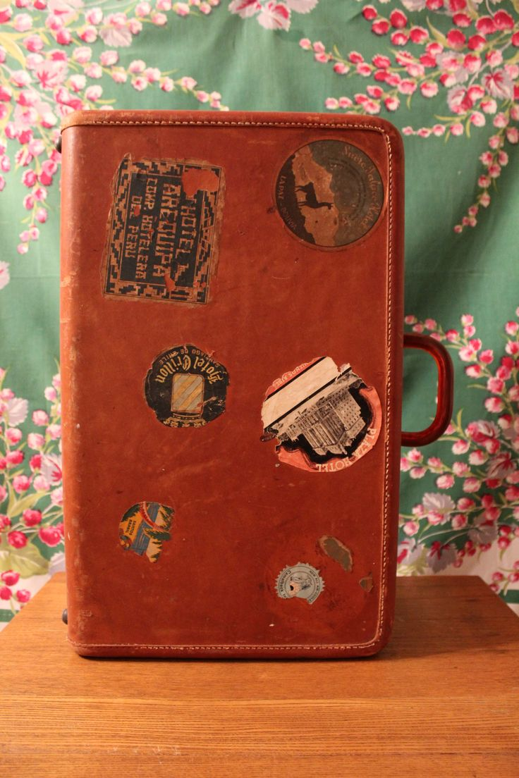 Vintage leather suitcase with travel stickers. One of many suitcases! Works well to receive cards or other small gifts, displaying favors, programs, flowers and more.