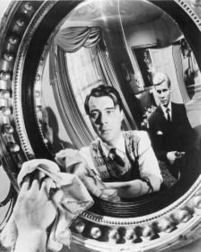 Dirk Bogarde and James Fox in The Servant.