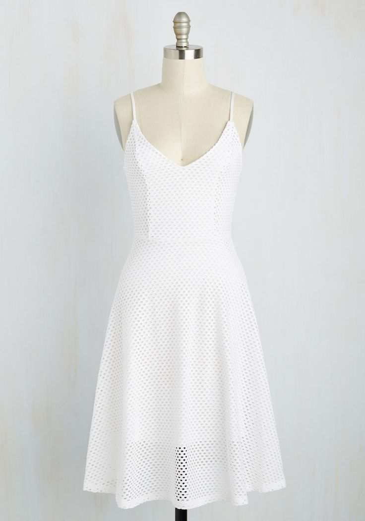 Like your confectionery creations, your look makes the grade thanks to this white sundress! Starring a white mesh overlay and princess seams, this strappy frock is a darling base for a sprinkling of sweet accessories.