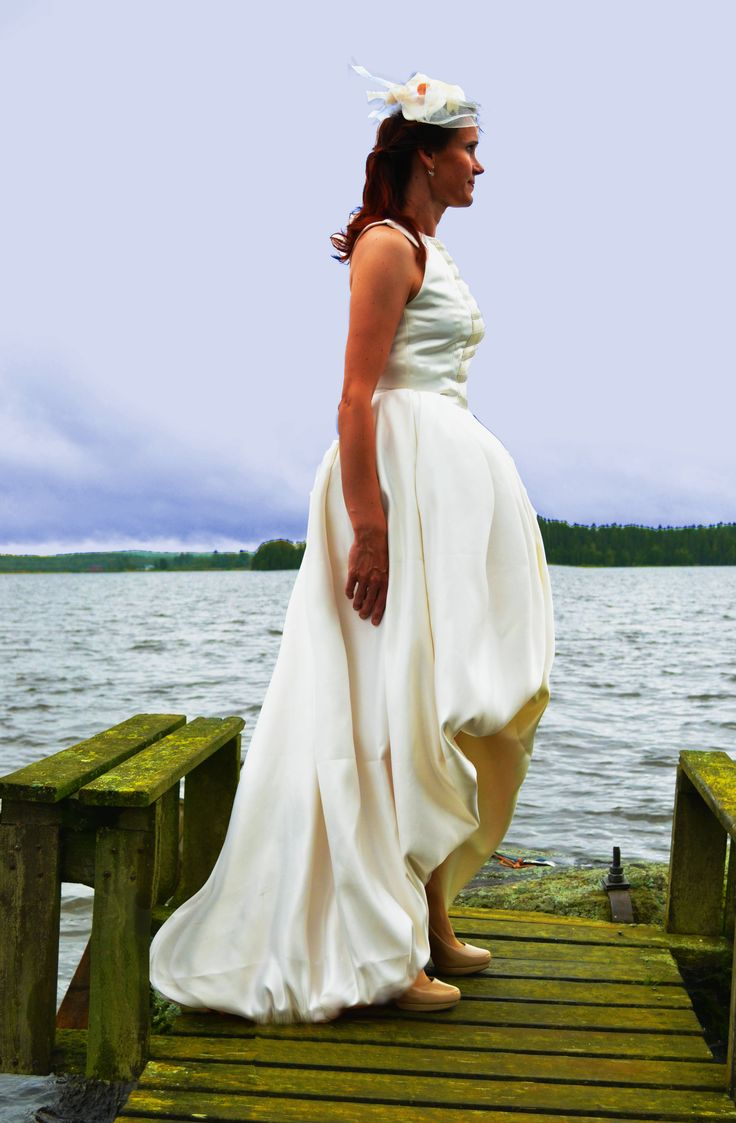 Simple white wedding dress, shorter on the front with a small train.