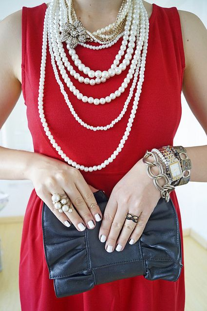 Elegant pearl necklace and black and white nails