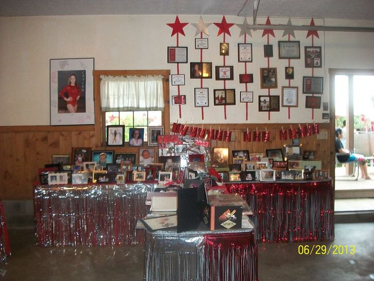 Grad party.Display tables of graduates pictures, awards ...