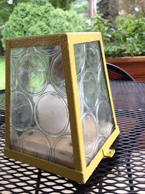 old rusty light turned into an outdoor candle holder - DIY