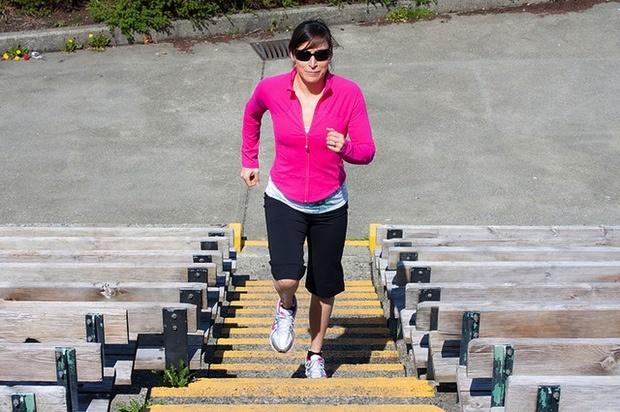 Running up a flight of stairs is a great cardio workout! You can sometimes do it at work too if you work in a multi-story building.