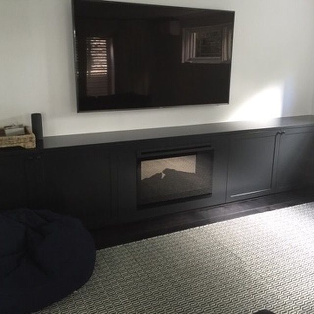 Heating fire place wall to wall cabinet on Domino Poly finish with shaker doors and adjustable shelves