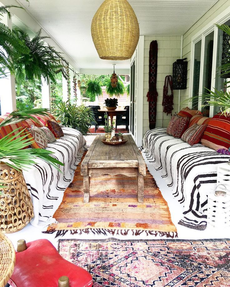 Summer Porch full of eclectic bohemian vibes moroccan rugs, stripes, boho outdoor space Fleamarketfab™️️ (@fleamarketfab)