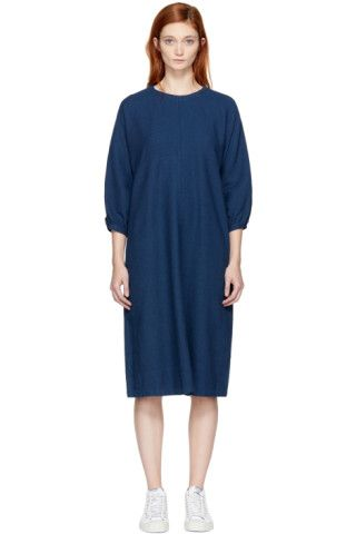 Three-quarter sleeve panelled 'wavy' woven cotton dress in indigo. Crewneck collar. Seam pockets at waist. Seamless armscyes. Gathering at single-button cuffs. Buttoned keyhole closure at back. Unlined. Tonal stitching.
