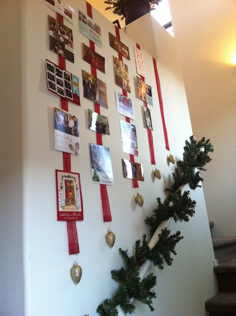 Christmas Card display - ribbons - I like the use of the stair well, the angel and the ornaments hung at the end of the ribbons... alone or with the cards this would be attractive.