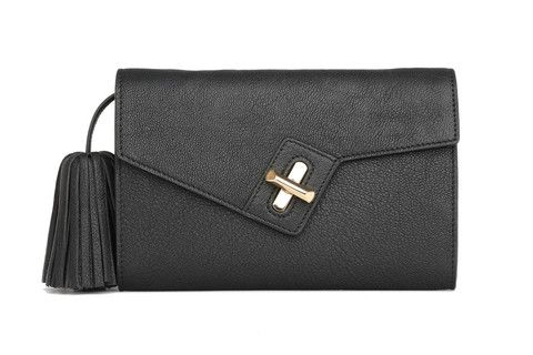 Mini MILCK Clutch Online Exclusive in black. Small, but not too tiny, this fulfills all the basic clutch duties. Meanwhile, the chain strap  gives it the versatility to sling crossbody and worn with a bit of edge.