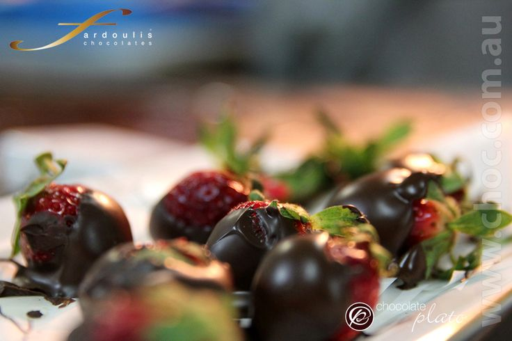 Chocolate dipped strawberries , if the chocolate has a shine , that is when you know it is real chocolate and tempered. Learn the art of chocolate www.choc.com.au