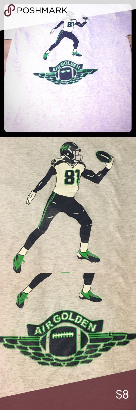 Air golden Seahawks Tee Nice thick yet with cotton with a particular Seattle Seahawks player on it..not sure who they are my friend says he is a current player a wide receiver he thinks... gonna look up and update this.  or what the golden motif is about but shirt is in perfect condition Gildan Shirts Tees - Short Sleeve