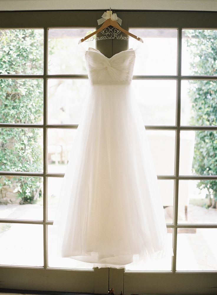Photography: Caroline Tran - carolinetran.net Wedding Dress: Reem Acra - www.reemacra.com   Read More on SMP: http://www.stylemepretty.com/2015/04/13/pastel-malibu-ranch-wedding/
