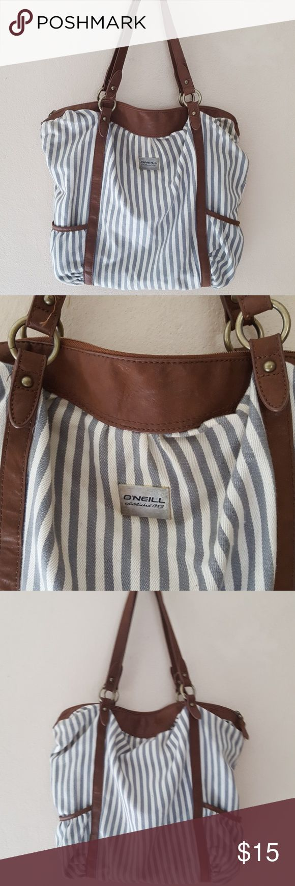 "Oneill Striped Fabric w/Contrast Trim Handbag Fun cotton striped handbag by Oneill. Measures 18"" long, and 15"" tall (excluding strap drop). The strap drop is 10"". Condition: pre owned, wear and tear such as fabric piling. O'Neill Bags Shoulder Bags"
