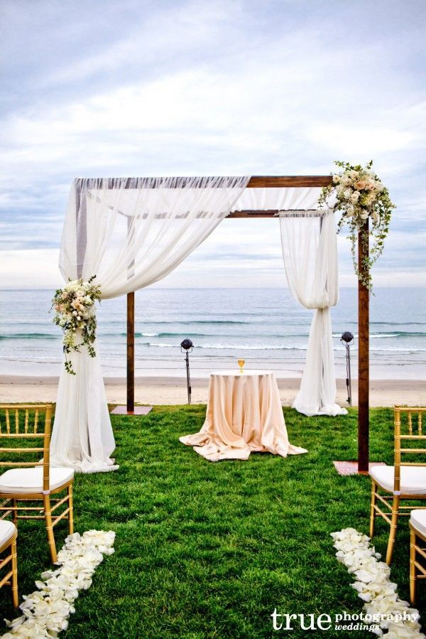 The angular quality of this ceremony altar with the softness of the fabric and romantic florals could be the perfect setting for your vows.
