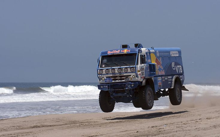 Russia's co-pilots Eduard Nikolaev, Sergey Savostin and Vladimir Rybakov in their Kamaz truck during the 4th stage of the Dakar Rally 2013 from Nazca to Arequipa, on January 8, 2013.
