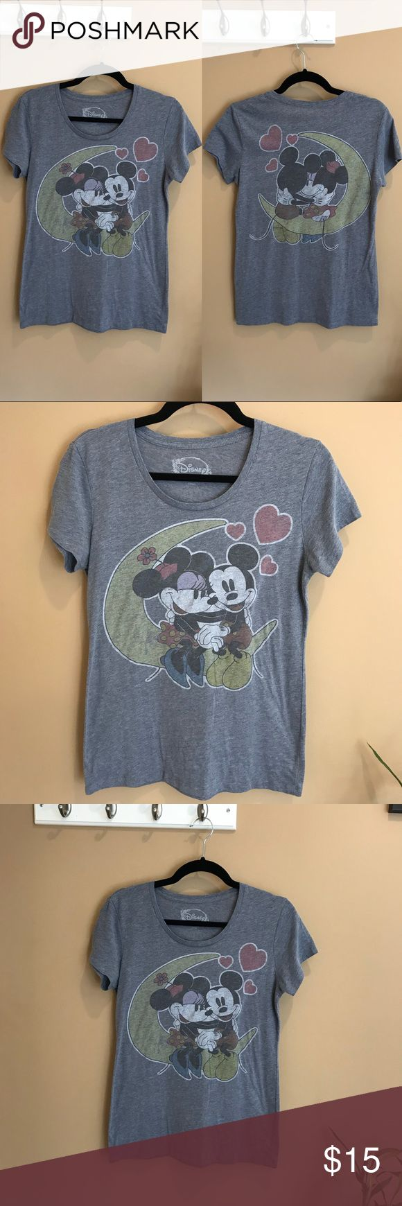Disney Mickey & Minnie Love & Hearts Moon T-Shirt Soft gray and in good condition with no flaws! Disney's Mickey & Minnie sitting on the moon with hearts. Over the moon in Love grey top. Comfortable. Size medium. Front and back feature cute graphic designs.   Perfect for any Disney lover — also a great Valentine's Day tee! Disney Tops Tees - Short Sleeve