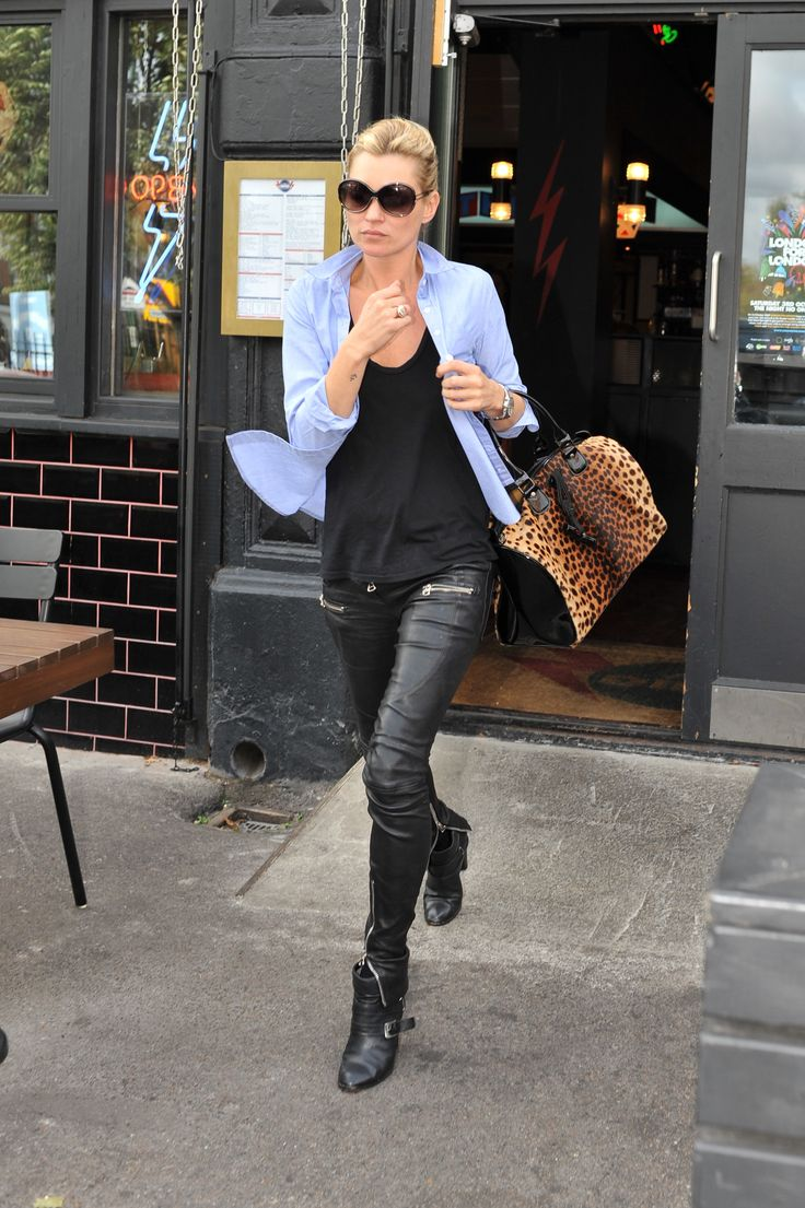 Leather pants with a black tank, blue button down, and leopard bag.