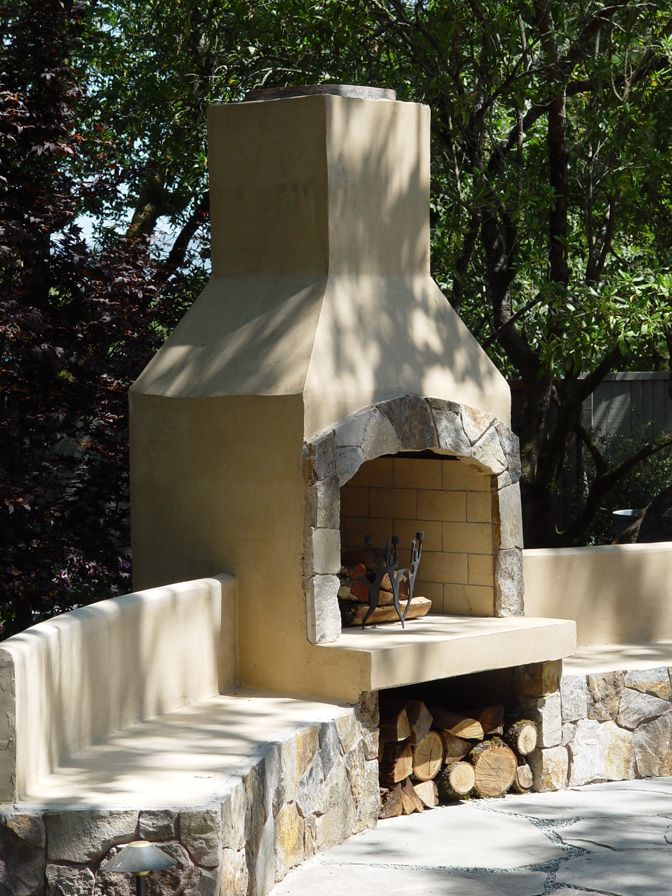 """36"""" Stone Age stucco fireplace with seatwalls."""