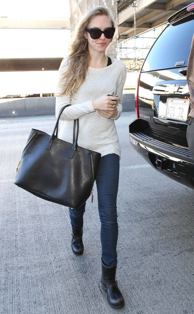 Fab Flyer from Celebrity Street Style  For a flight out of LAX, Amanda Seyfried wears a roomy white sweater, skinny jeans and motorcycle boots. A sleek black tote serves as a chic carry-on item.