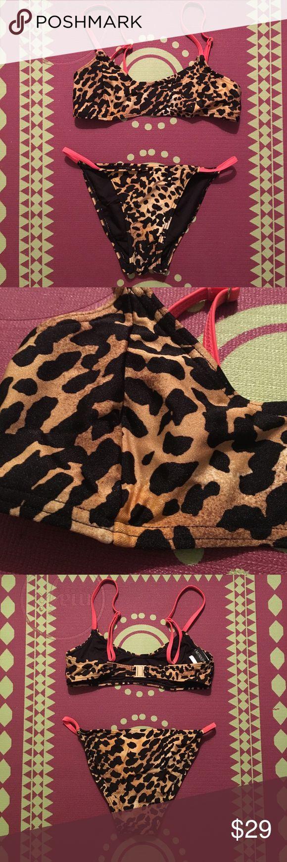 Minkpink Bikini Leopard print Minkpink bikini. Super cute and sassy. Top and bottom included. Size XS and true to size. Very gently worn, almost like new. No fading. MINKPINK Swim Bikinis