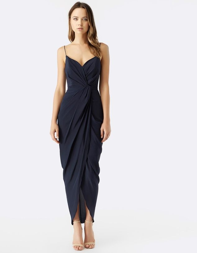 Crafted from stunning silk Rodeo Show's Saskia Maxi Dress falls perfectly. The silhouette embraces the body in a deep navy hue, pair with simple accessories to complete the look.