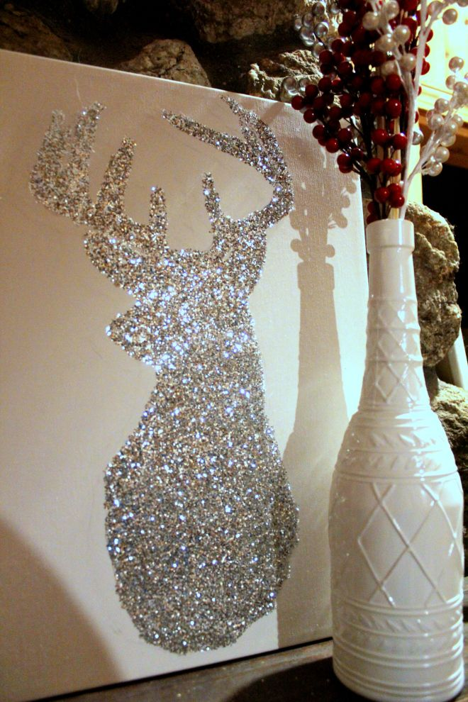 Stencil a reindeer silhoutte and glitter the inside of it on canvas. Perfect to sit on top of a mantel