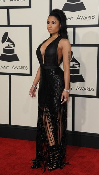 I'm surprised Nicki Manaj showed up to the Grammy's looking so...normal. I love this dress that's part skirt, part full-length ballgown