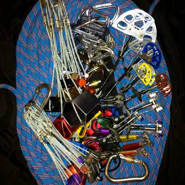 Essential rock climbing equipment for traditional lead climbing.