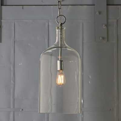 Modern Farmhouse Kitchen DesignThe light fixture above the island is the Glass Jug Lantern from Shades of Light – $179 each