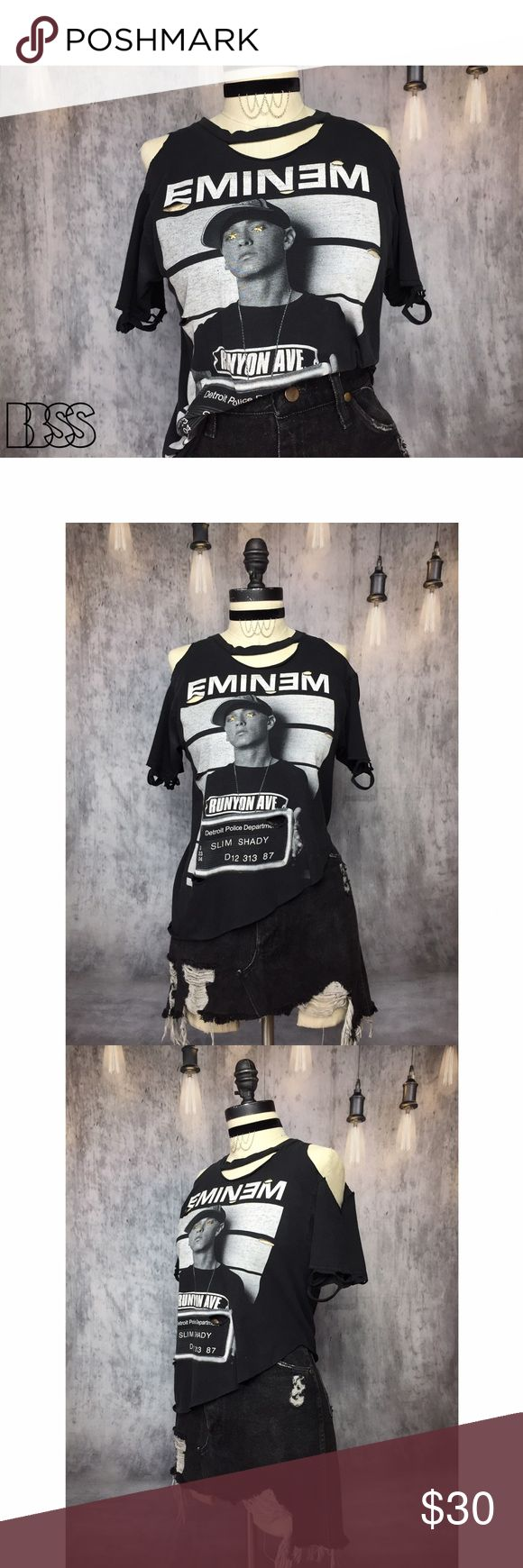 SLIM SHADY OG EMINEM DISTRESSED COLD SHOULDER TEE! SLIM SHADY OG EMINEM DISTRESSED COLD SHOULDER TEE! Awesome STARRY EYED graphic tee with open shoulders and distressing details!! Top is cut asymmetrical! Great style to knot up on on side or tuck into high waisted bottoms! Fabric is super thin worn in faded vintage black! RUNYON AVE - D12 313 87 - DETROIT POLICE DEPARTMENT. MEASUREMENTS - BUST: 16' / LENGTH: 22.5' (longest) 15' (shortest) #festival #concert #band #grunge Vintage Tops Tees…