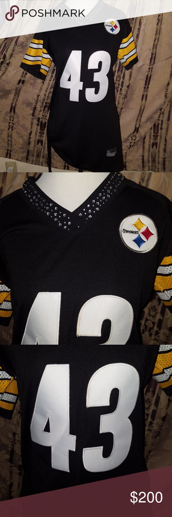 Pittsburgh Steelers EMBELLISHED FITTED 43 JERSEY Pittsburgh Steelers EMBELLISHED FITTED 43 JERSEY ~ Polamalu Crystal encrusted VNECK ~ cinched side and asymetrical on other. Stitched lettering. Made by Reebok and very RARE. It is New without Tags. Be the envy if all your friends with this rare jersey! Ladies Medium. I ship daily Reebok Tops