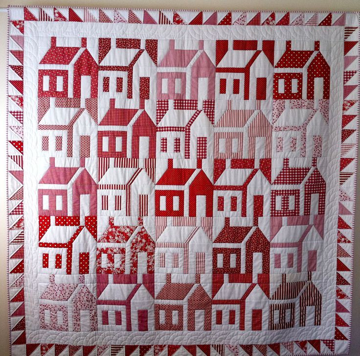 Red & white house quilt.  The shadings & color inversion make it look like a neighborhood rather than a collection of house blocks.