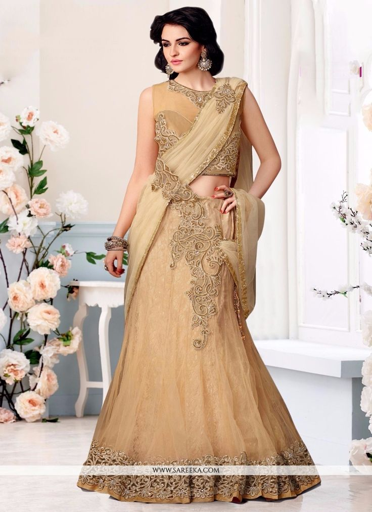Be an angel and create and establish a smashing impression on everyone by wearing this beige net lehenga saree. The embroidered and patch border work looks chic and aspiration for any get together. Co...