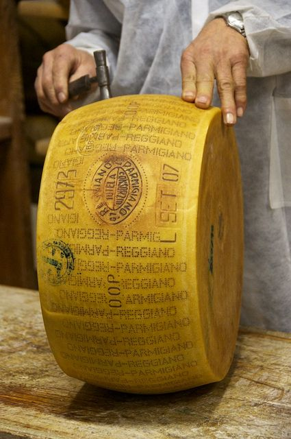 Each parmiggiano-reggiano wheel is inspected individually and given the stamp of approval.