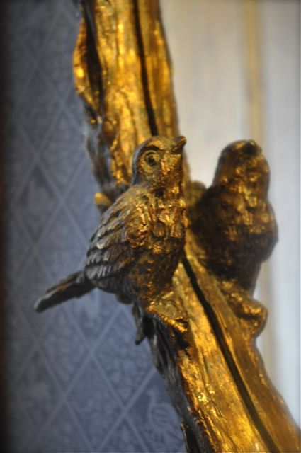 Bird on mirror frame