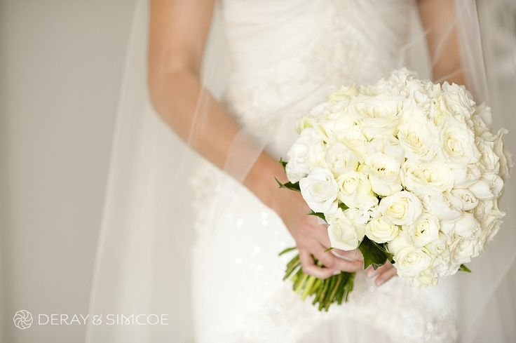 Classic white rose bride's bouquet by Flowers in Bloom. Photography by DeRay & Simcoe