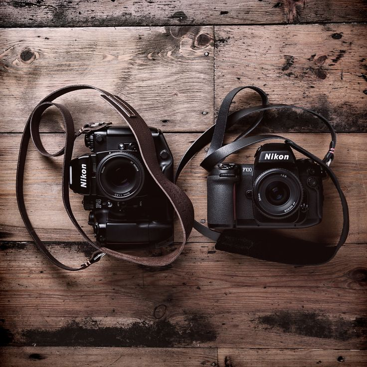 Nikon F4 and Nikon F100 with our handmade leather camera neck straps.
