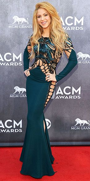 Country Goes Couture: The Looks of the ACMs | SHAKIRA | We started to count the number of cutouts on the singer's supercool blue-green Zuhair Murad gown, but stopped when we realized it would take too long. And really, are they still called cutouts when the dress looks inspired by a spiderweb or a threadbare tee?
