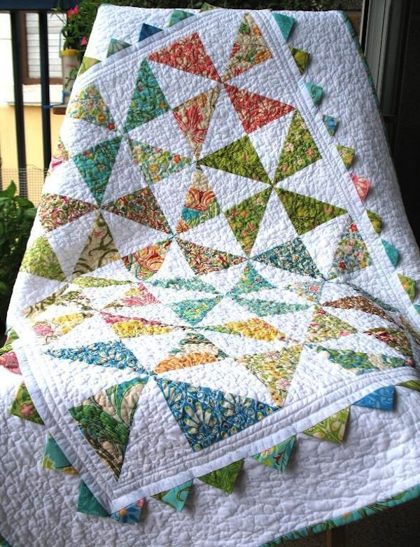 Round and round they go! Learn how to make simple and advanced pinwheel quilts and blocks for dynamic projects with these pinwheel quilt patterns.