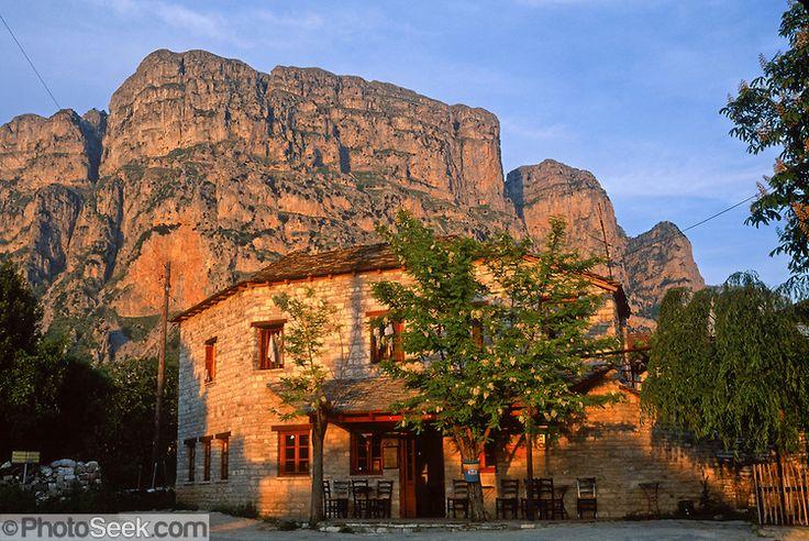 Vikos village, Zagoria, north Pindus Mountains (Pindos or Pindhos), Epirus/Epiros, Greece, Europe. The northeast wall of Vikos Gorge is Mount Tymfi
