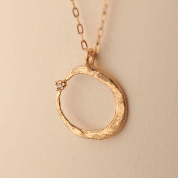 Crescent Hugs a Diamond Necklace