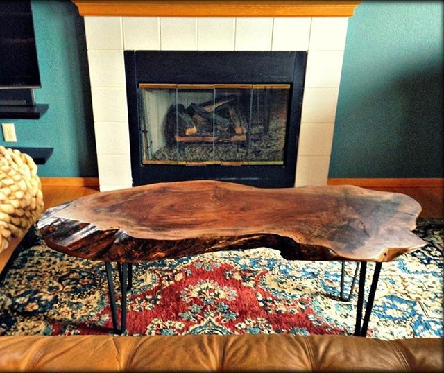 Black Walnut custom coffee table, with metal hairpin legs. Photo taken by client after delivery. Wood slab furniture.