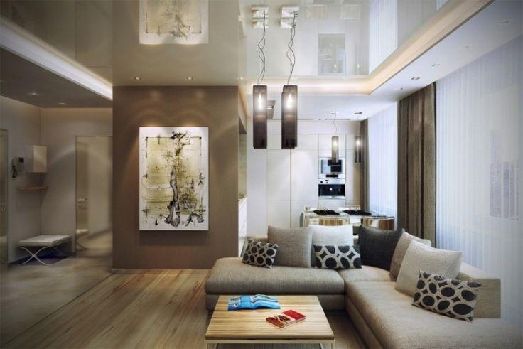 ameublement salon moderne - canapé d'angle en gris clair avec coussins décoratifs en noir et blanc, rideaux en marron et blanc, table basse en bois et éclairage indirect